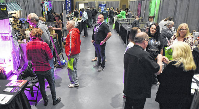 Area residents attend the Ohio Holistic Health & Cannabis Expo at Veterans Memorial Civic Center in Lima on Friday.