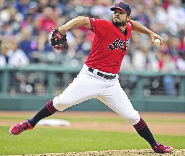 Cleveland Indians relief pitcher Brad Hand delivers a pitch in the ninth inning of a 3-1 win over the Toronto Blue Jays on Sunday in Cleveland.