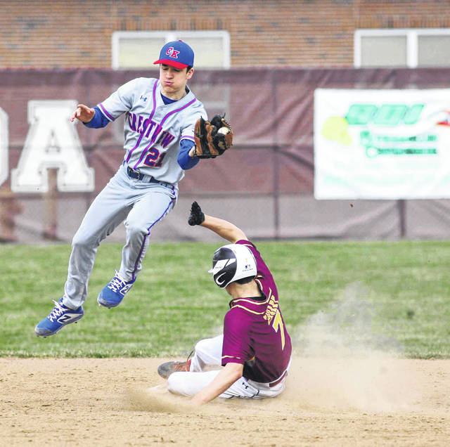 Kalida's Luke Erhart slides safely into second base as Crestview's Logan Geradot fields the high throw during Saturday's game at Kalida.