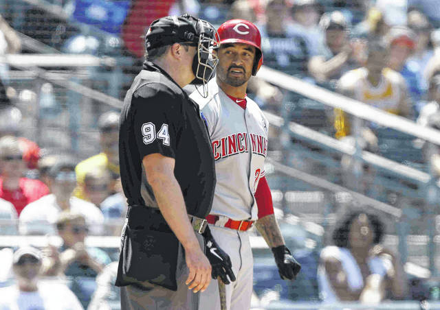 Cincinnati Reds' Matt Kemp, right, talks with umpire Lance Barrett after being called out on strikes during the fourth inning of a baseball game against the San Diego Padres in San Diego, Sunday, April 21, 2019. (AP Photo/Alex Gallardo)
