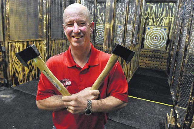 Kevin Wieging, president of Ultra Sound Special Events in Delphos, stands inside his new six-lane indoor axe throwing range. Kevin Wieging, president of Ultra Sound Special Events in Delphos, stands inside his new six-lane indoor axe throwing range.