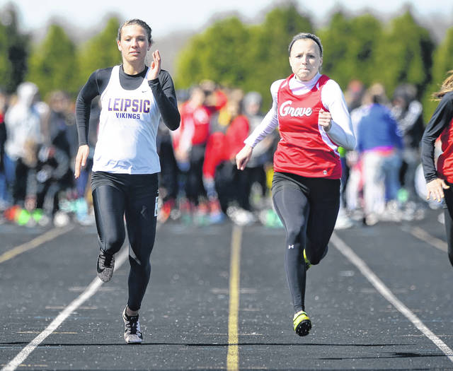 Leipsic's Carlee Siefker, left, and Columbus Grove's Rylee Sybert compete in the 100 meter dash during Saturday's Liberty-Benton Pat Wagner Memorial Invitational.