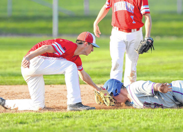 Lima Central Catholic's Michael Briggs tags out Crestview's Korbin Hartman at second base during a stolen base attempt at Players Field.