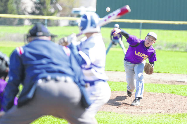 Leipsic's Dylan Schroeder pitches to Liberty-Benton's Anthony Wolford during Saturday's game at Leipsic.