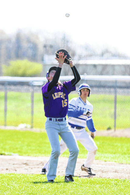 Leipsic's Tylor Sickmiller brings in a pop-up during Saturday's game against Liberty-Benton at Leipsic.