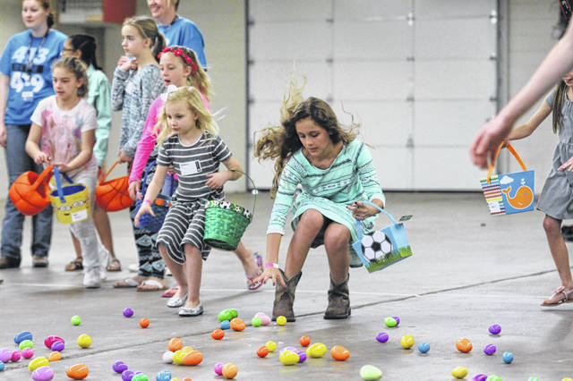 Children partake in last year's Easter egg hunt at the Allen County Fairgrounds.