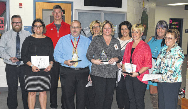 Lima schools honored the Outstanding 11 at Monday's board meeting.