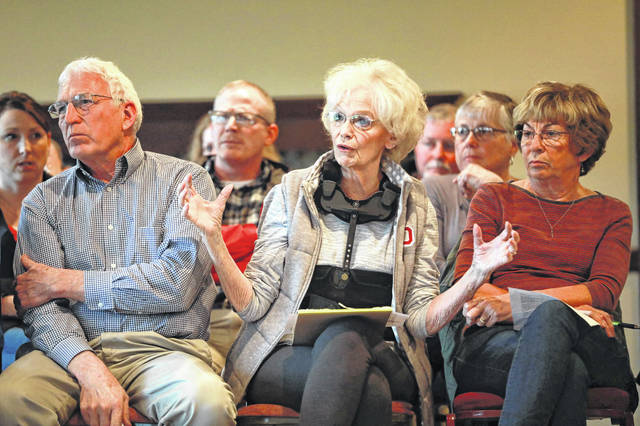 Ruth Hollenbacher, president of Lost Creek Neighborhood Association, expresses her concerns Thursday about the possible Bath housing developement at the Lost Creek Golfers Club. Amanda Wilson | The Lima News