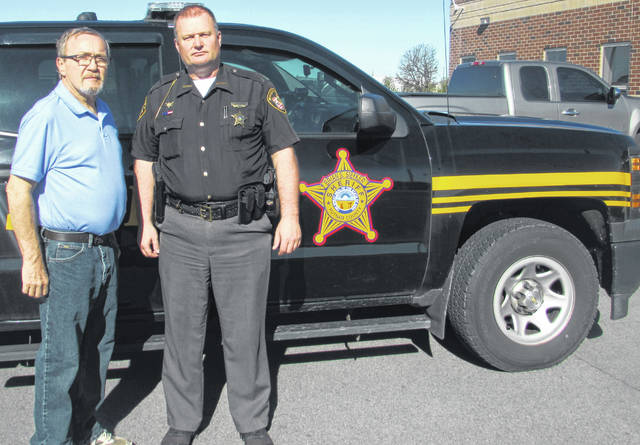 Pictured from left are Marvin Schwiebert, who has retired from law enforcement after 44 years, and Putnam County Sheriff Brian Siefker.