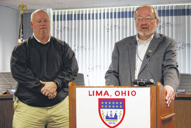 Lima Mayor David Berger, right, on Wednesday issued a proclamation recognizing April 26 as Arbor Day in the city. Parks and rec supervisor Ric Stolly, pictured at left, said an Arbor Day tree-planting ceremony will be held at 1 p.m. Friday at Lima Central Catholic High School.