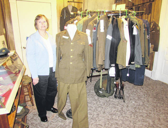 Pictured is Carol Wise, Putnam County Historical Society and Museum curator, next to a World War I uniform that will be part of a new display that is being planned to showcase military items from Putnam County residents. Military items and newspaper articles are part of the military display at the Putnam County Historical Society and Museum.