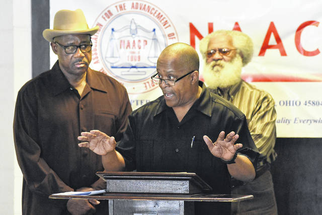 Ron Fails, center, president of the Lima chapter of the NAACP, talked Wednesday about allegations of racial profiling and discrimination against minorities targeted for traffic violations. Craig J. Orosz | The Lima News