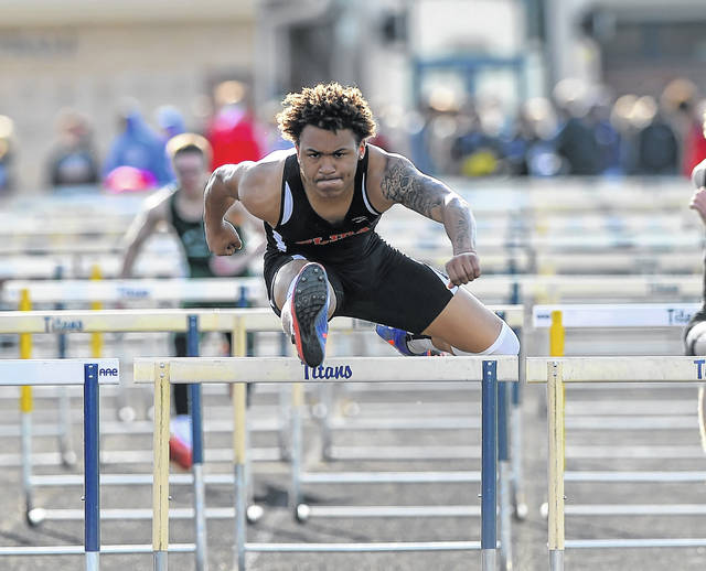 Elida's KeShawn Spivey competes in the 110-meter hurdles during Friday night's Ottawa-Glandorf Gold Medal Track and Field Meet.