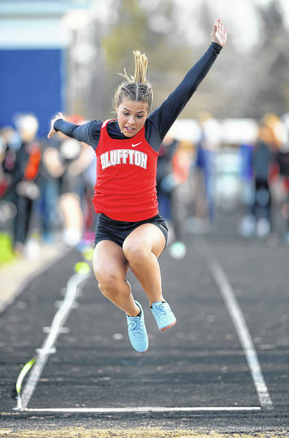 Bluffton's Bella Basinger competes in the long jump during Friday night's Ottawa-Glandorf Gold Medal Track and Field Meet.