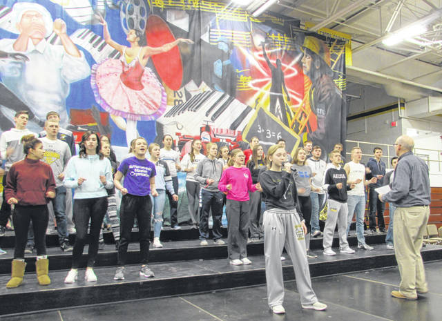 Ottawa-Glandorf High School Out Of The Blue Show Choir members practice for this weekend's dinner theater performance led by Choral Director Ted Ellerbrock, who is retiring June 1.