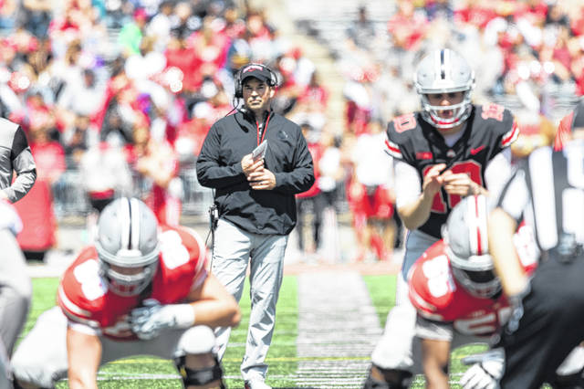 Ohio State coach watches as quarterback Danny Vanatsky (10) runs the offense during Saturday's spring game at Ohio Stadium in Columbus.