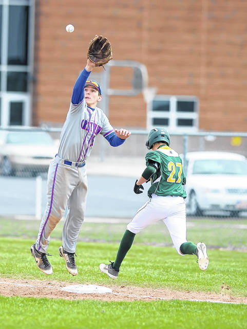Crestview's Brant Richardson leaps for a throw as Ottoville's Brice Schroeder heads to first base during Saturday's game at Ottoville High School.