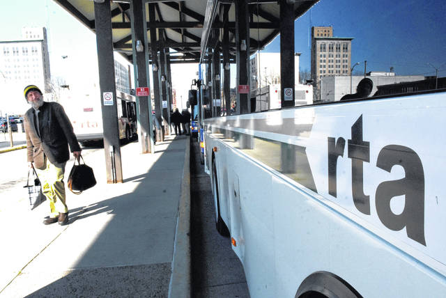 Passengers exit RTA buses at the station downtown. Allen County RTA is concerned about its operations budget and will ask voters for help.