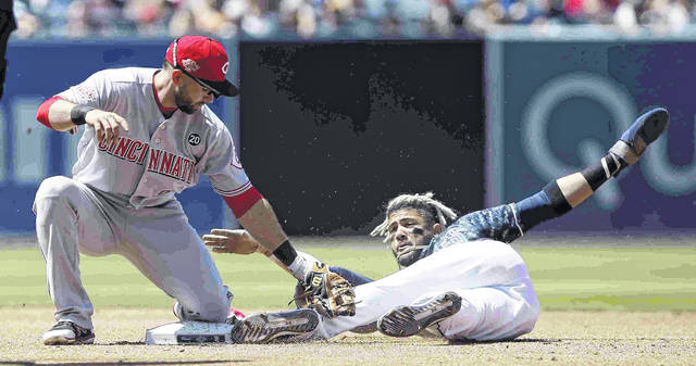Cincinnati Reds second baseman Jose Peraza, left, tags out San Diego Padres' Fernando Tatis Jr. caught stealing during the third inning of a baseball game in San Diego, Sunday, April 21, 2019. (AP Photo/Alex Gallardo)