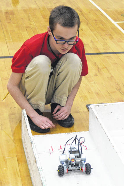 Evan Large, an eighth-grader at South Science Magnet & Technology School, puts his robot through a maze at the annual STEAM Night.