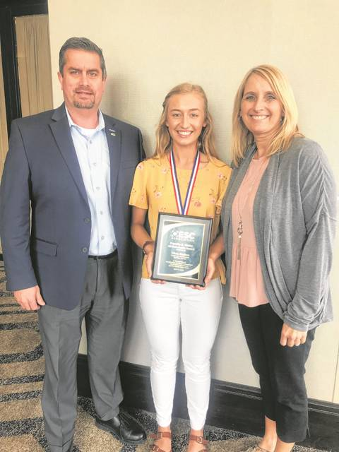 Olivia Skelton, with her parents Wes and Tina Skelton, accepted the Franklin B. Walter All-Scholastic Award presented by the OESC Association in Columbus.