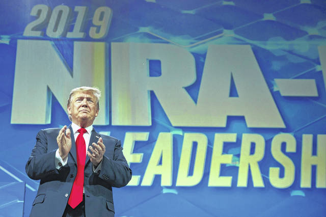 President Donald Trump arrives to speak to the annual meeting of the National Rifle Association, Friday, April 26, 2019, in Indianapolis. (AP Photo/Evan Vucci)