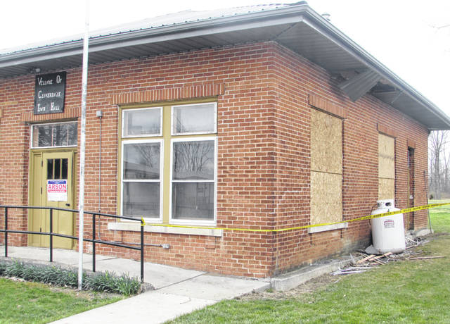 Caution tape and boarded-up windows were placed at Cloverdale Town Hall to prevent anyone from entering it after a Sunday morning fire. Officials suspect arson.