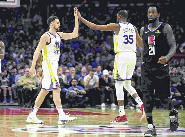 Golden State Warriors guard Klay Thompson, left, and forward Kevin Durant, center, congratulate each other as Los Angeles Clippers guard Patrick Beverley walks by during the second half in Game 4 of a first-round NBA basketball playoff series Sunday, April 21, 2019, in Los Angeles. The Warriors won 113-105. (AP Photo/Mark J. Terrill)