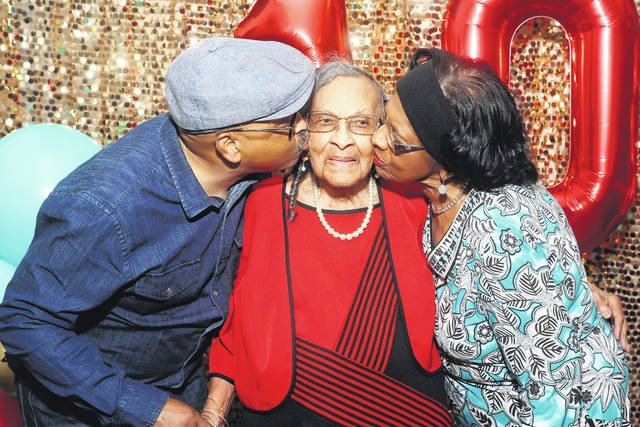 Gary Wilson and Barbara Banks plant a kiss on their mother, Thelma Wilson, of Lima, who turned 103 on Wednesday.