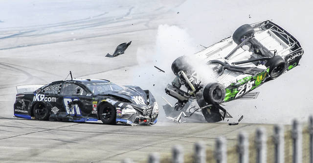 Monster Energy NASCAR Cup Series driver Kyle Larson (42) flips as he makes contact with Jeffrey Earnhardt (81) on the back stretch during the Geico 500 at Talladega Superspeedway on Sunday in Talladega, Ala.