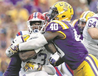 LSU linebacker Devin White (40), here stopping Louisiana Tech running back Jaqwis Dancy last season, may be available for Cincinnati to draft with the 11th overall pick in this year's NFL draft.