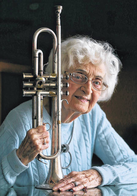 This March 28, 2019 photo shows Mona Schaffer at The Venue Banquets in Tallmadge, Ohio. Schaeffer, a 96-year-old trumpeter, mother and grandmother, has played more gigs in more bands than most of her bandmates combined, and she's still going strong. Schaeffer's tenure is as unique as her entry into the Serenaders. The band was founded by the local Masons, who at the time did not allow women to perform.