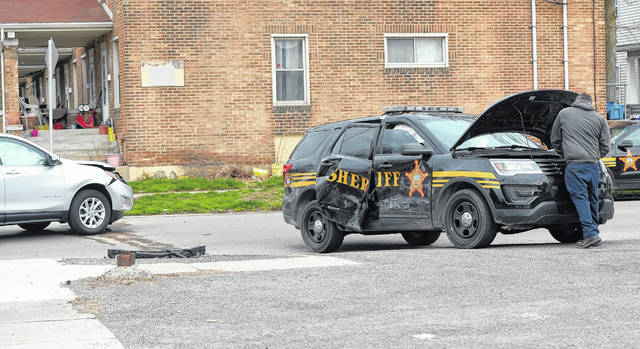 The Lima Fire Department responded to a collision between a car and an Allen County Sheriff's Office cruiser at the interssection of West McKibben and North Elizabeth streets around 8:30 a.m. Tuesday morning.