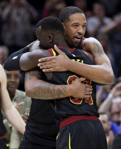 Channing Frye, right, hugs Deng Adel after the Cavaliers' final game of the season Tuesday night against Charlotte in Cleveland. Frye had earlier announced that this was going to be his final NBA season. (AP photo)