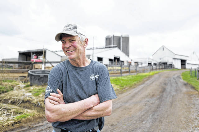 Dwight Raber, of Raber Dairy Farms in northeast Ohio's Stark County, says he can no longer make a living by milking cows and has lost money the last two years. State statistics show the number of dairy farms in Ohio dropped to fewer than 2,000. ( Julie Vennitti/The Canton Repository via AP)