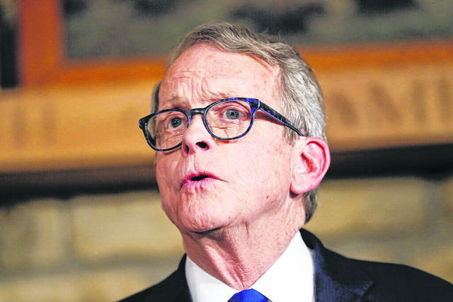 Republican Gov. Mike DeWine and the GOP controlled House are at odds. AP Photo