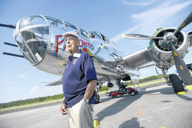 "FILE - In this April 16, 2013 file photo, Doolittle Raider Lt. Col. Dick Cole, stands in front of a B-25 at the Destin Airport in Destin, Fla. before a flight as part of the Doolittle Raider 71st Anniversary Reunion. Retired Lt. Col. Richard ""Dick"" Cole, the last of the 80 Doolittle Tokyo Raiders who carried out the daring U.S. attack on Japan during World War II, has died at a military hospital in Texas. He was 103. A spokesman says Cole died Tuesday, April 9, 2019, at Brooke Army Medical Center in San Antonio, Texas."
