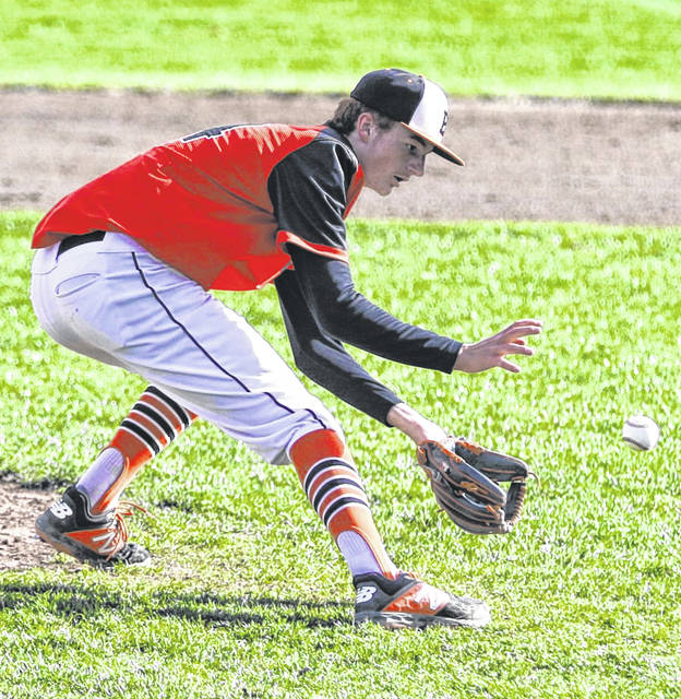 Elida's Brayden Lybarger fields a grounder during Friday's game against Celina at Ed Sandy Field. Levi A. Morman | The Lima News