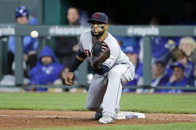 Cleveland's Carlos Santana waits for the throw for an inning-ending out during Saturday night's game against they Royals at Kauffman Stadium in Kansas City, Mo. (AP photo)