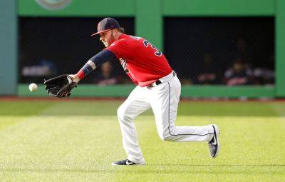 The Indians' Tyler Naquin fields a ball hit by Miami's Brian Anderson during Tuesday's game in Cleveland. Anderson was safe at first base. (AP photo)
