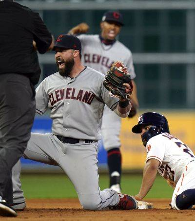 Cleveland's Jason Kipnis reacts after tagging out the Astros' Jose Altuve at second base on a steal attempt during the eighth inning of Thursday night's game in Houston. (AP photo)