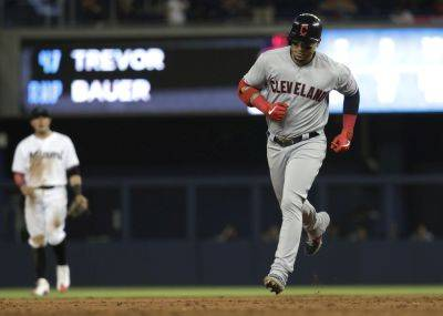 Cleveland's Carlos Gonzalez runs the bases after hitting a three-run home run during Tuesday night's game against the Marlins in Miami. (AP photo)