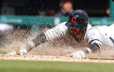 Cleveland's Eric Stamets beats the throw to safely slide into home during Tuesday's game against the Tigers in Detroit. (AP photo)