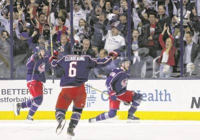 The Blue Jackets' Pierre-Luc Dubois, right, celebrates his goal Tuesday night against the Tampa Bay Lightning with teammates Oliver Bjorkstrand, left, and Adam Clendening during Game 4 of an NHL first-round playoff series in Columbus.
