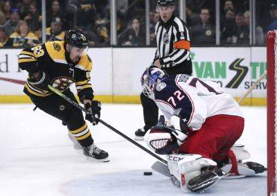 Columbus' Sergei Bobrovsky (72) makes a save on a shot by the Bruins' Brad Marchand during Game 1 of a second-round playoff series Thursday in Boston. (AP photo)