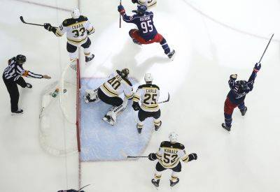The Blue Jackets' Matt Duchene, top, and Nick Foligno, right, celebrate Duchene's goal against Boston during the second period of Game 3 of a second-round playoff series Tuesday night in Columbus. (AP photo)