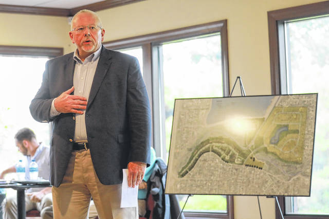 Michael Blass, of Blass Residential Services, shares his plans for a housing developement at the Lost Creek Golfers Club. Amanda Wilson | The Lima News