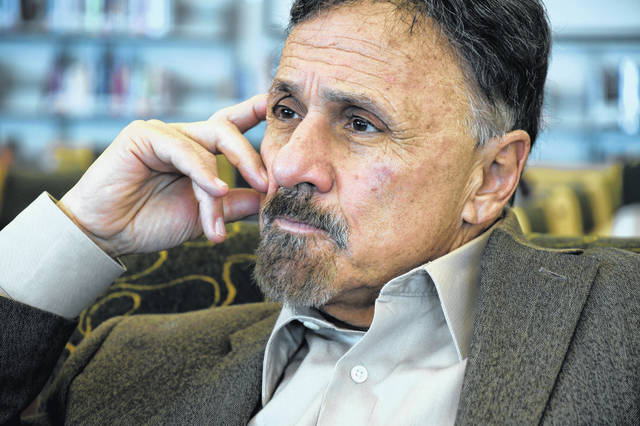 FILE - In this March 23, 2019 file photo, former Columbine principal Frank DeAngelis reflects about the upcoming 20th anniversary of the mass shooting at the suburban Denver high school. More than a dozen principals from U.S. schools impacted by shootings have formed a support network for the next colleagues who join their unenviable ranks. The Principals Recovery Network will also advocate for resources to help schools prevent violence. The initial group of 17 includes DeAngelis and a principal from Marjory Stoneman Douglas High School in Parkland, Florida. DeAngelis says it's a network each participant wishes they'd had.