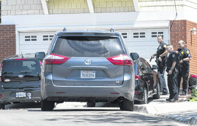 San Diego Police stay across from the house thought to be the home of 19 year-old John T. Earnest, who is a suspect in the shooting of several people in a Poway synagogue, on Saturday in San Diego, Calif. The gunman used an AR-type assault weapon to shoot worshippers. (John Gibbins/The San Diego Union-Tribune)
