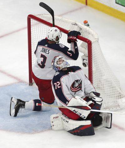 Columbus goaltender Sergei Bobrovsky and defenseman Seth Jones (3) react after a goal by the Bruins' Brad Marchand during the third period of Game 5 of a second-round playoff series Saturday in Boston. (AP photo)